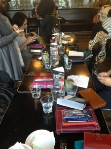 Filofax On Table Mobiles In Hands